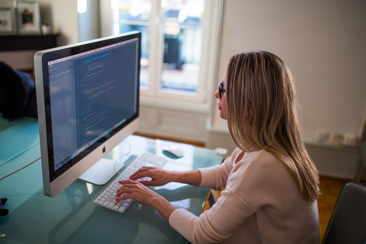 image showing a woman at a computer working as a content writer